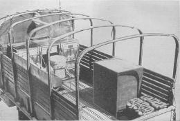 An overhead view of an Army kitchen truck showing the M1937 field ranges and a home-made ice chest